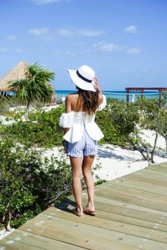 white floppy hat_ peplum top_ beach outfit