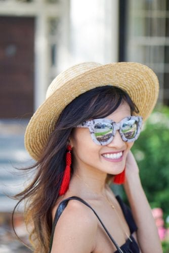 boat hat, cat eye glasses, marble sunglasses, red tassel earrings, liberti us