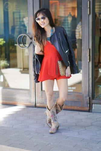 RED ROMPER, CORRAL BOOTS, BLACK LEATHER JACKET, STUDDED CLUTCH, QUAY SUNNIES