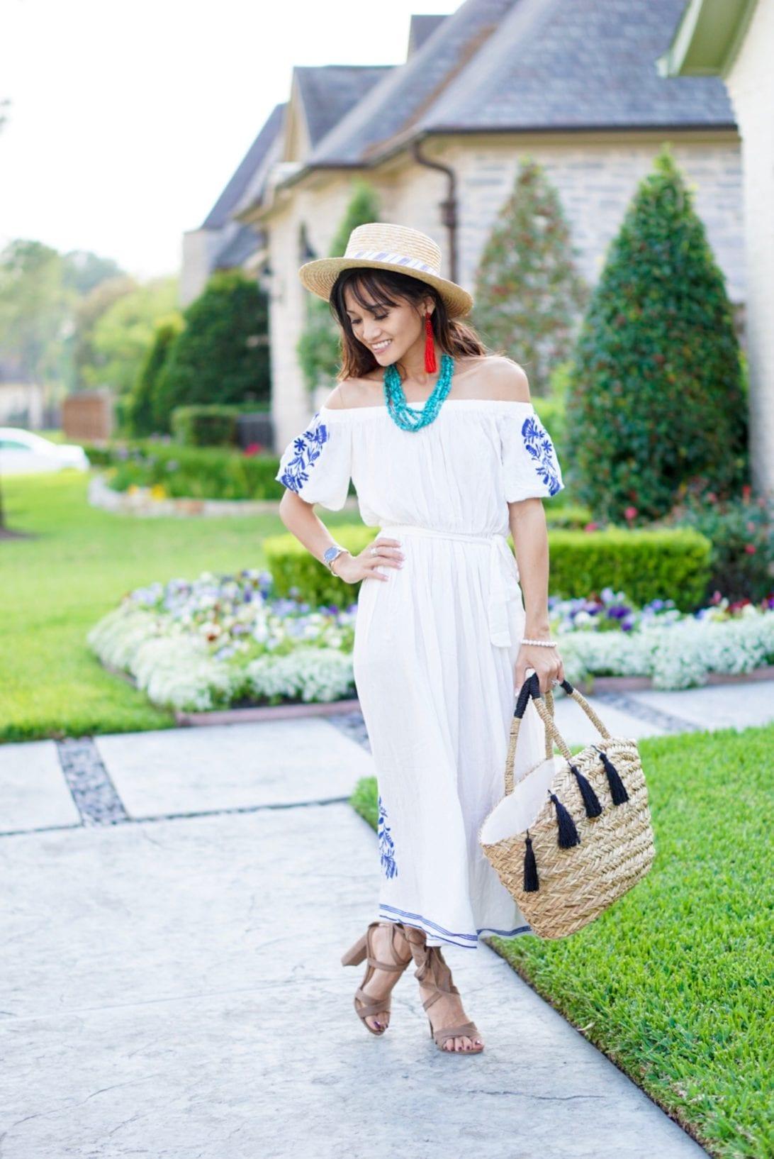 embroidered white dress, red tassel earrings, boater hat, tassel beach bag, summer outfit