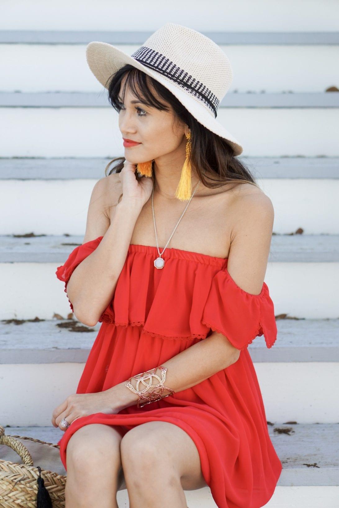 kendra scott necklace, yellow tassel earrings, cuff, summer hat, red off the shoulder dress
