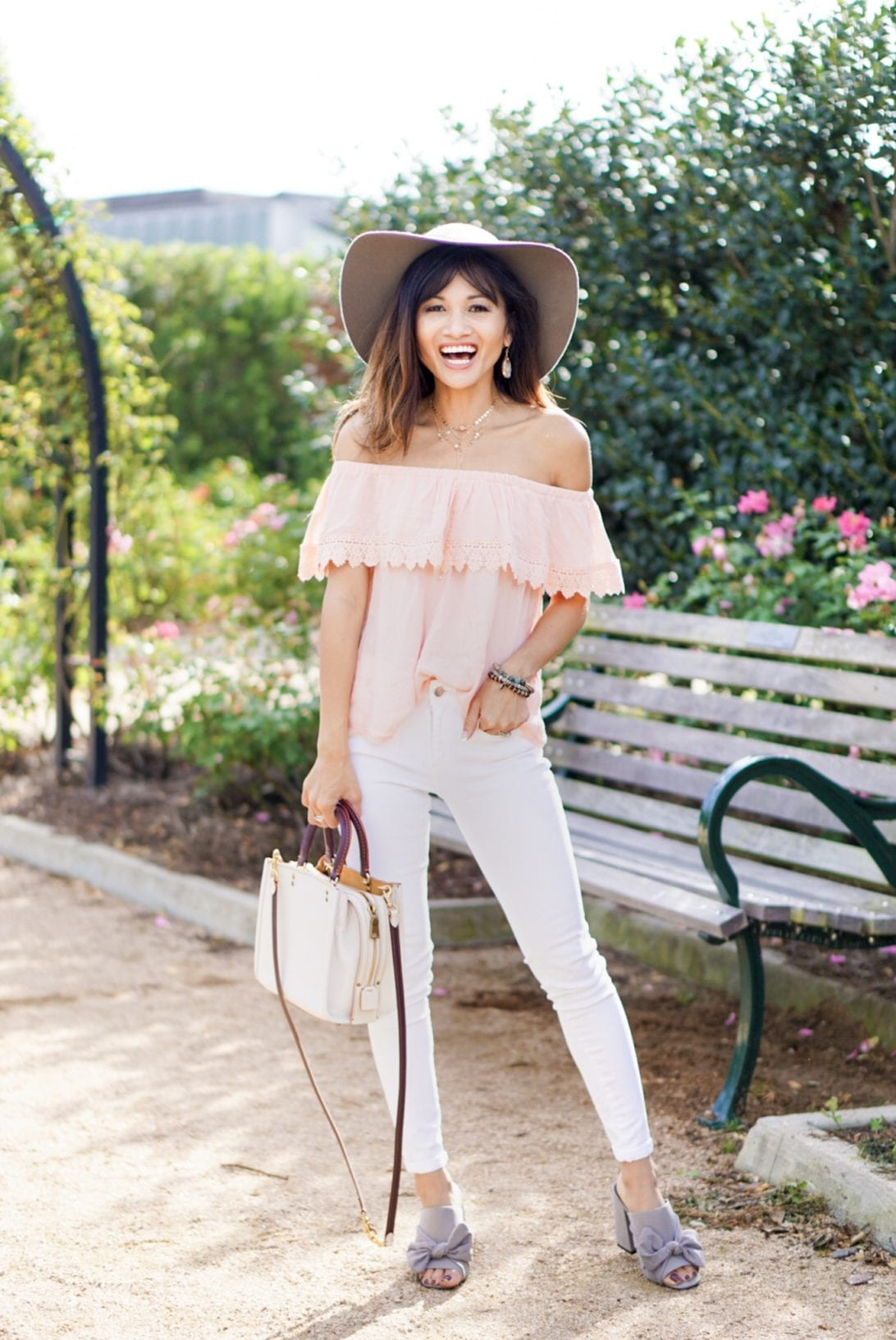 floppy hat, off the shoulder top, coach bag, bow mules, white skinny jeans, outfit, charming charlie