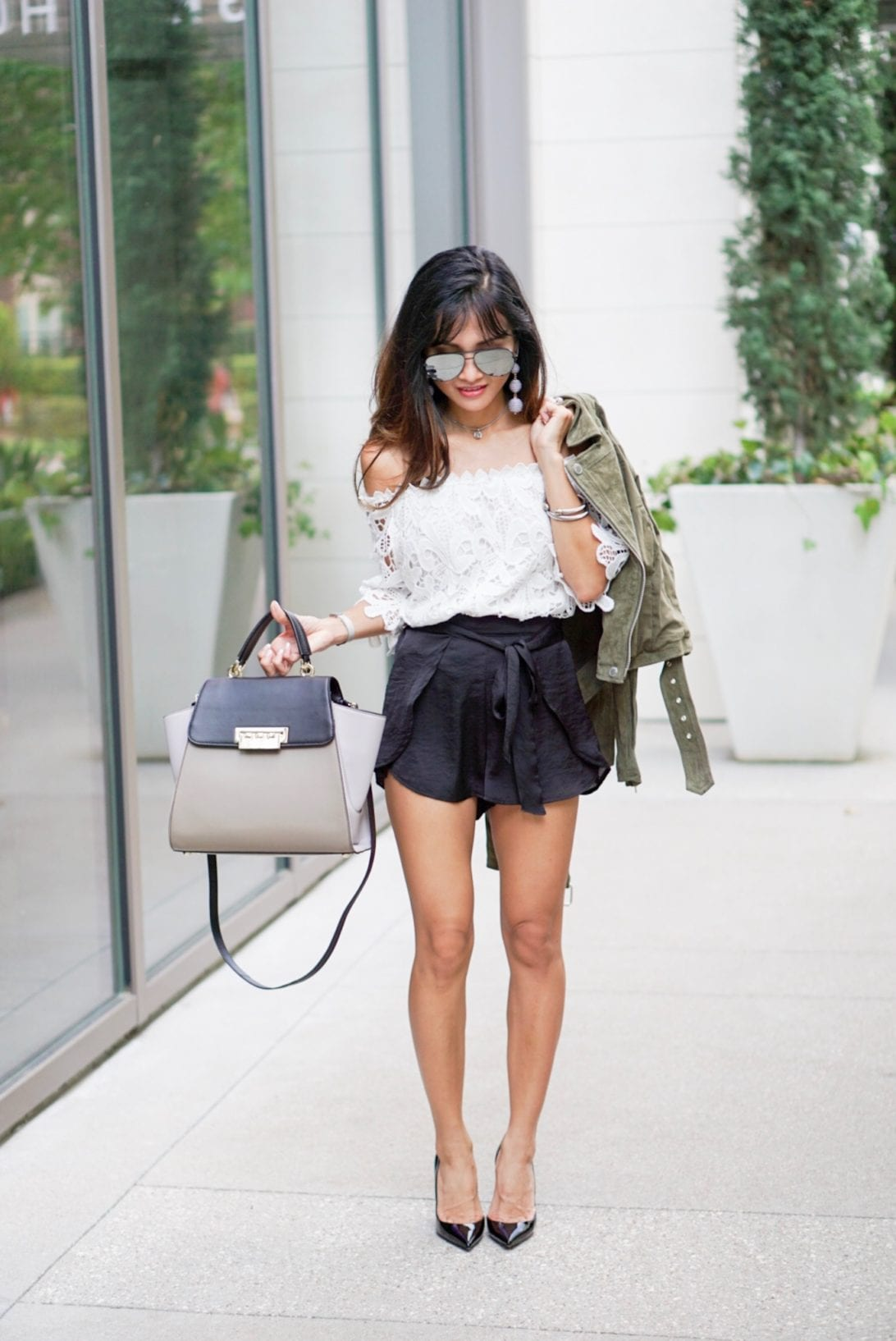 ball drop earrings, austin earrings, charming charlie, tie front shorts, satin shorts, lace top, olive moto jacket, sued jacket, ily couture, blank NYC , black pumps, dorsal pumps, louboutins, red soles