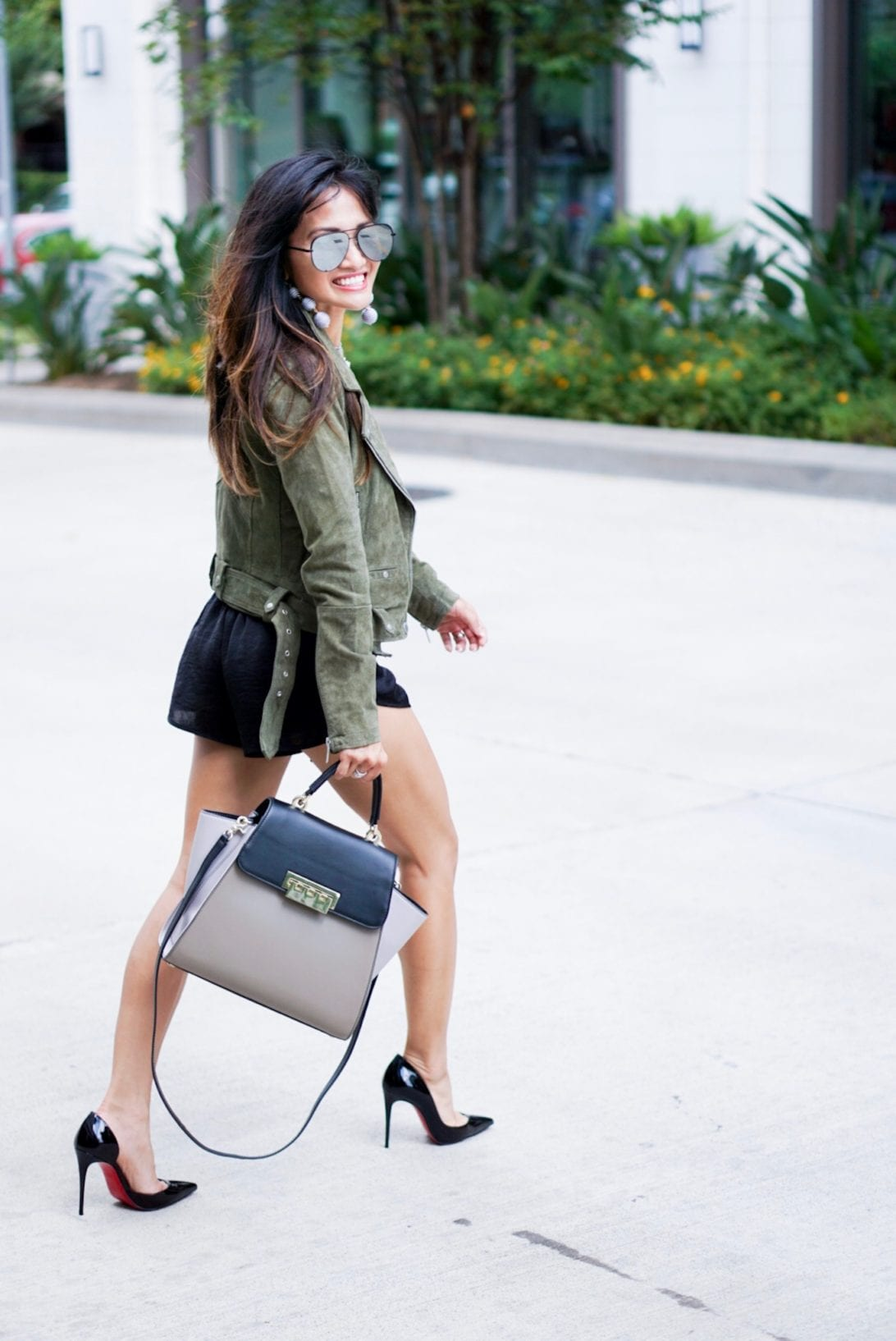 ball drop earrings, austin earrings, charming charlie, tie front shorts, satin shorts, lace top, olive moto jacket, sued jacket, ily couture, blank NYC , black pumps, dorsal pumps, louboutins, red soles, quay sunglasses