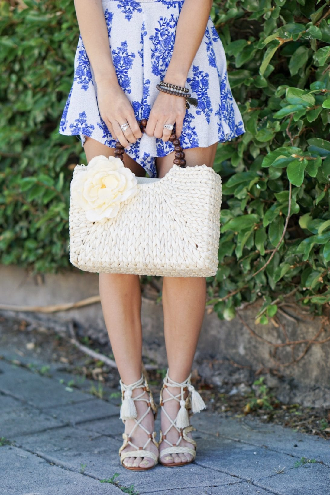 raffia woven lace-up block heel, blue ruffle romper, quay sunglasses, tassel earrings, charming charlie, blush and stone boutique, straw bag, amazon, summer outfit, summer style, summer accessories,