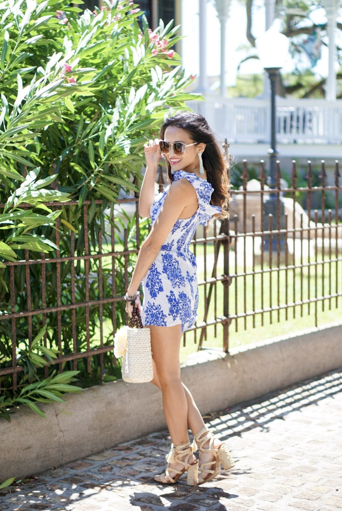 raffia woven lace-up block heel, blue ruffle romper, quay sunglasses, tassel earrings, charming charlie, blush and stone boutique,