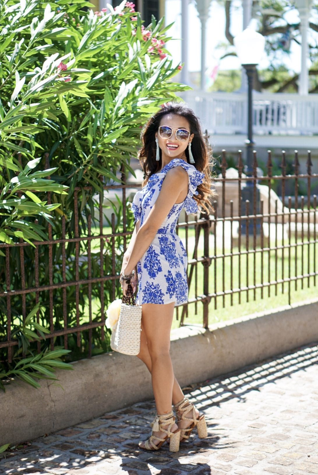raffia woven lace-up block heel, blue ruffle romper, quay sunglasses, tassel earrings, charming charlie, blush and stone boutique, straw bag, amazon, summer outfit, summer style, summer accessories, off the shoulder romper