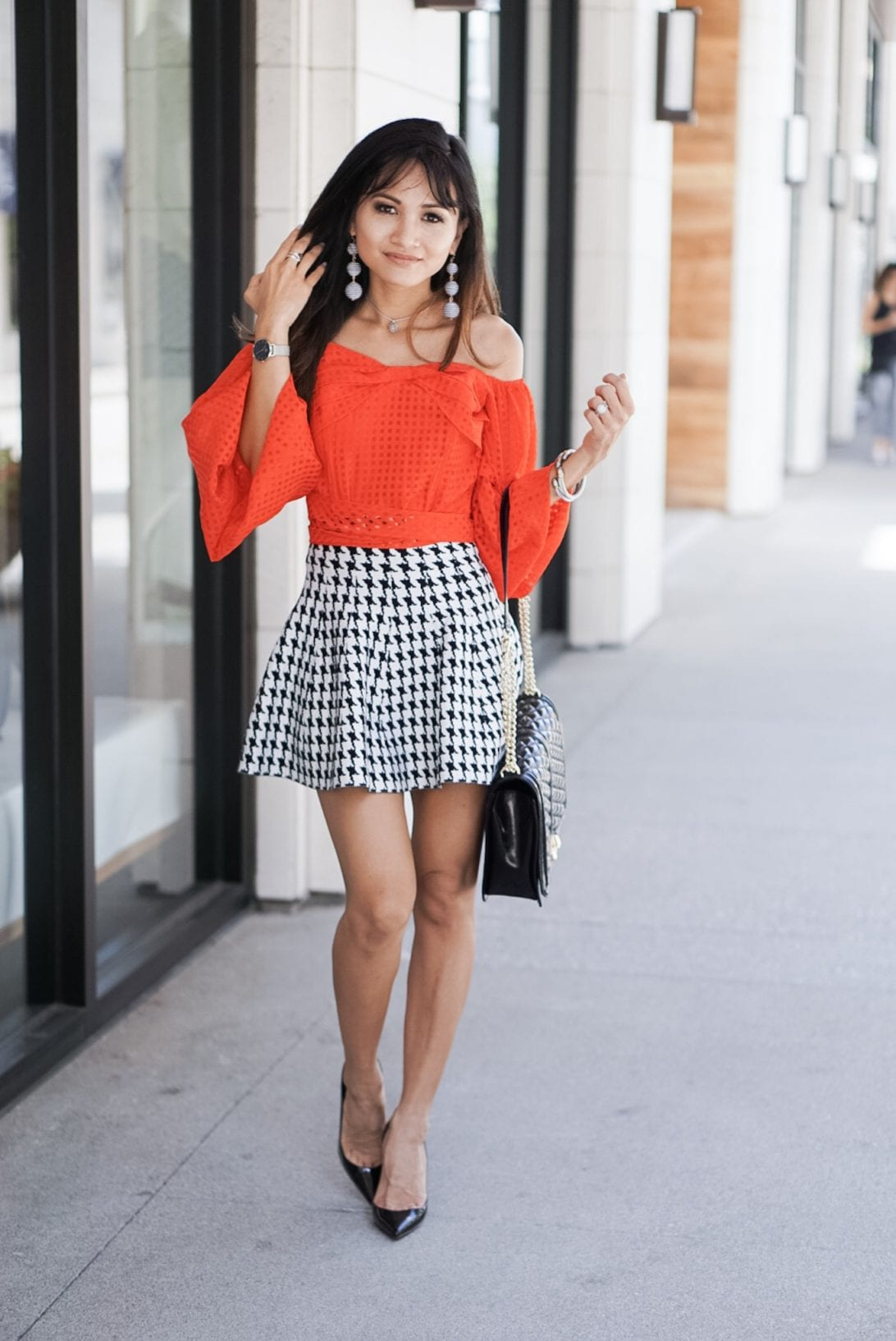 RED OFF THE SHOULDER BASKET WEAVE TOP WITH BOW TIE WAIST, houndstooth skirt, puff sleeves, love cross body bag, flap bag, louboutin heels, black patent heels