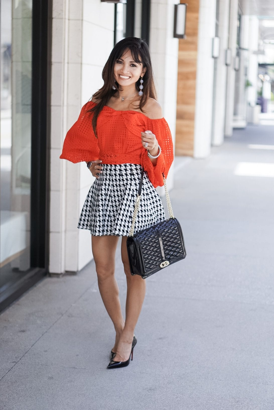 RED OFF THE SHOULDER BASKET WEAVE TOP WITH BOW TIE WAIST, houndstooth skirt, puff sleeves, love cross body bag, flap bag, louboutin heels, black patent heels, rebecca minkoff bag