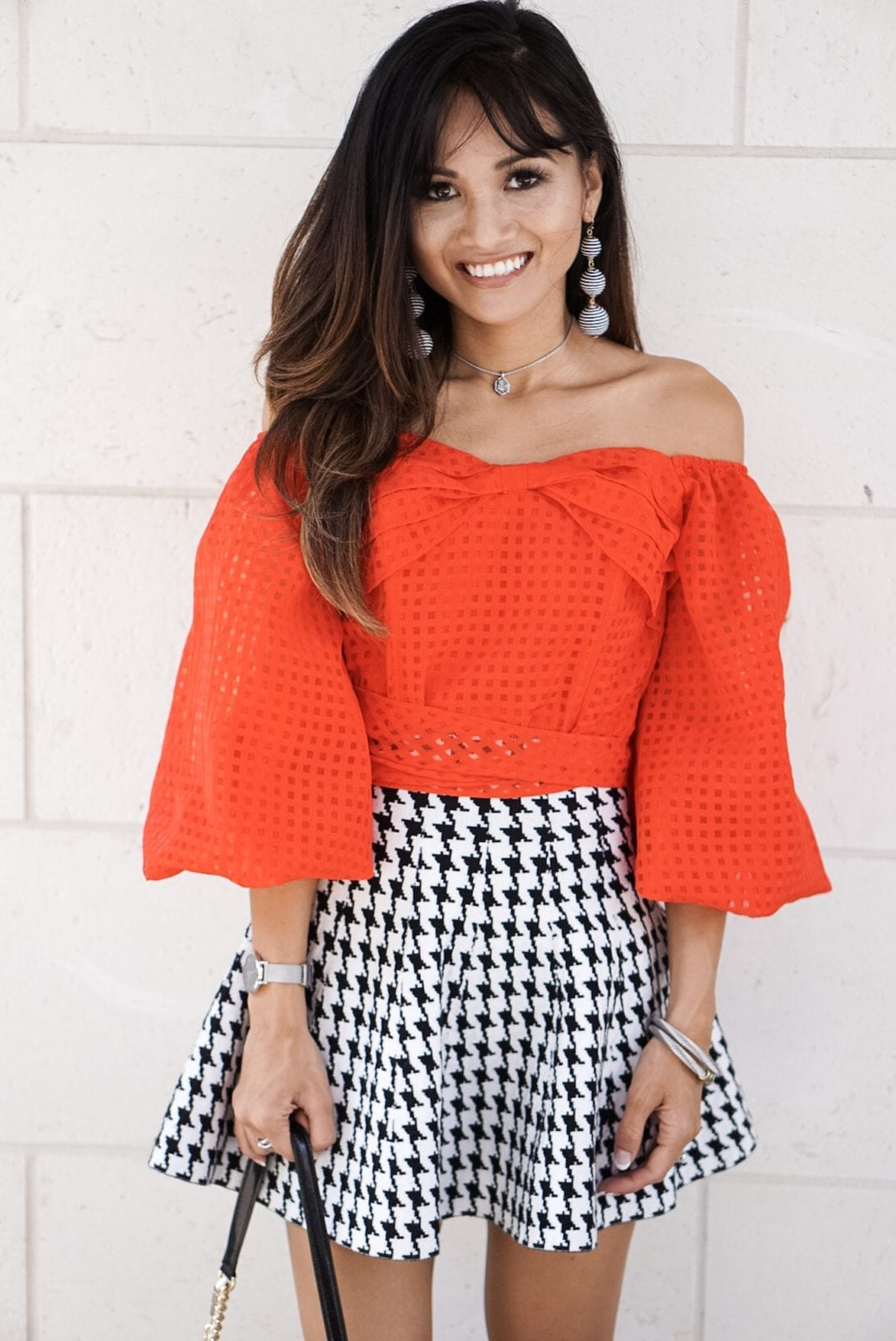 houndstooth skirt, mini skirt, red off the shoulder top, drop ball earrings