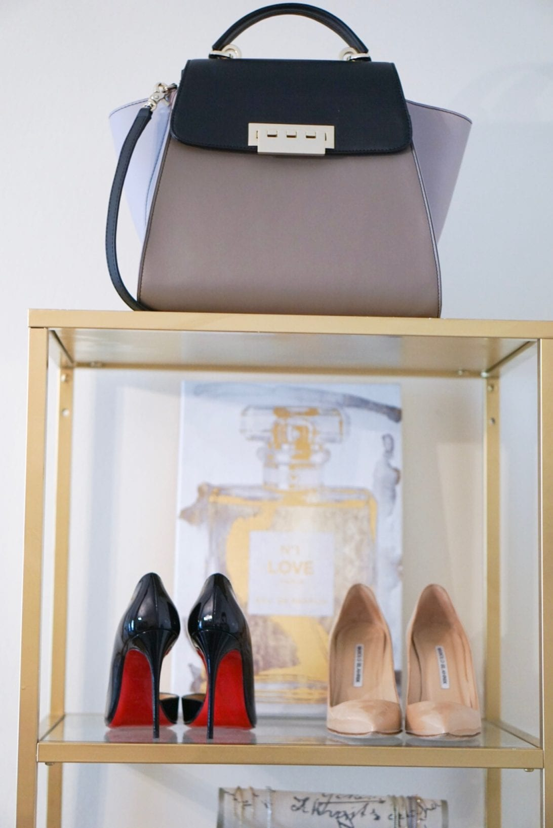 ZAC zac posen bag, christian louboutin shoes, manolo blanik, chanel, wall art, office, shoe display