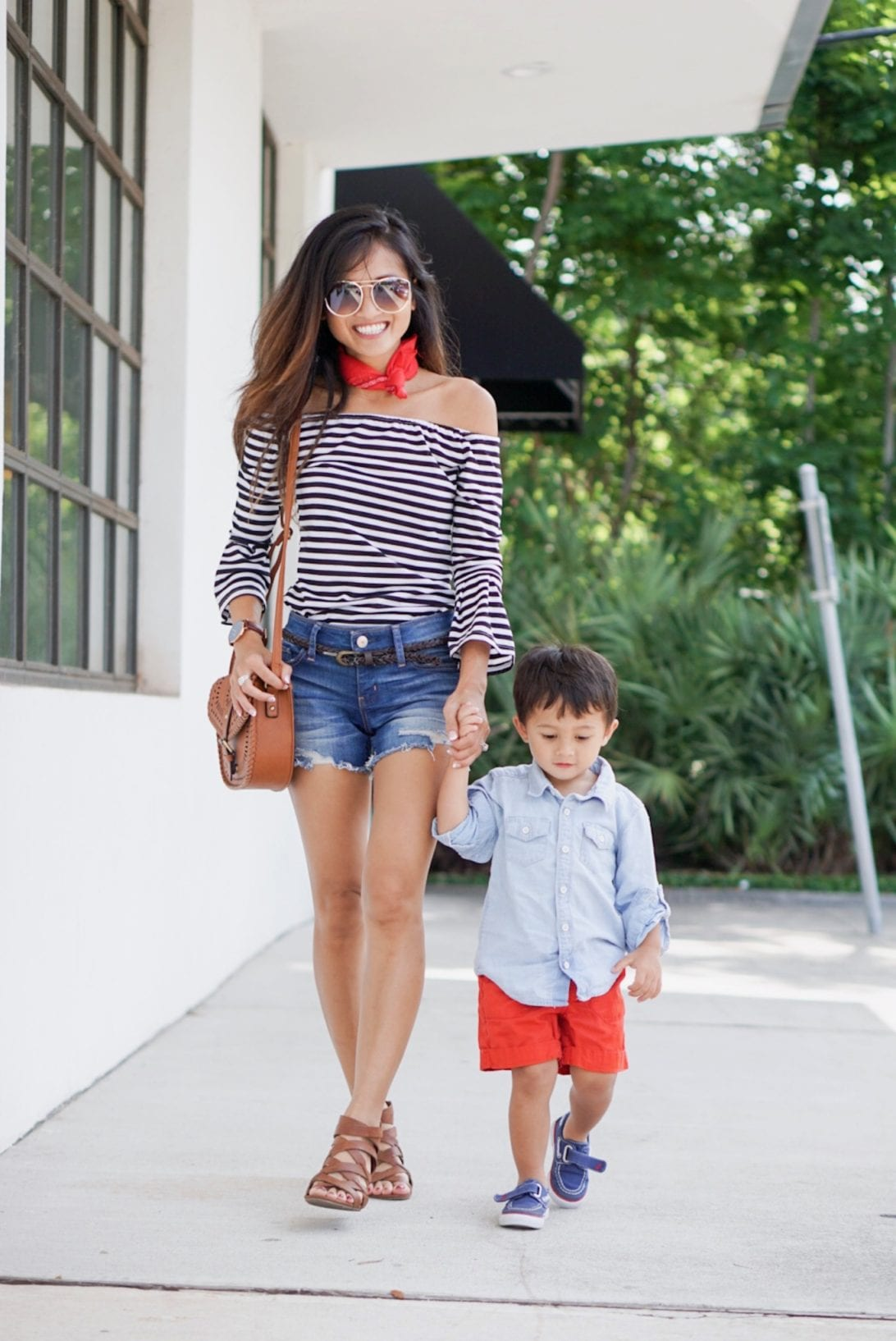 red bandana, neck scarf, striped top, off the shoulder, gladiators, mom shorts, mommy and me, boy mom, toddler boy, outfits, 4th of july, quay sunglasses, cross body bag