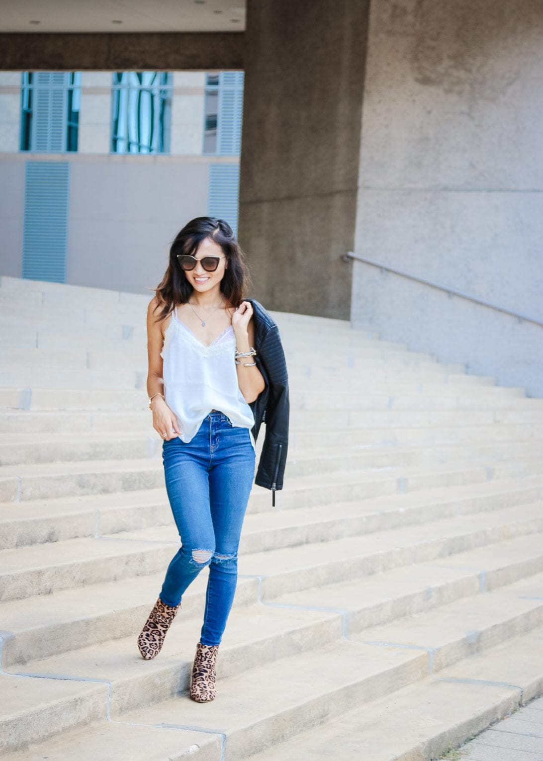 what to wear after Labor Day, Labor Day outfit, leather moto jacket, black leather jacket, moto jacket, ripped jeans, leopard booties, Prada sunglasses, statement booties, fall outfit