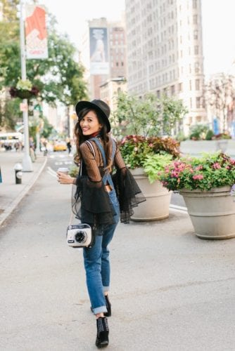 NYFW OUTFIT, NYFW STREET STYLE, New York FASHION WEEK, New York CITY, OUTFIT, STYLE, FALL OUTFIT, BLACK FEDORA, BELL SLEEVE TOP, HOW TO WEAR OVERALLS, DENIM OVERALLS, OVERALLS, FLATIRON, NYC, NYFW RECAP, STUDDED BOOTIES, #NYFW2017