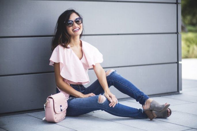 Prada sunglasses, pink frill top, chicwish, high waisted skinny jeans, wear pink, pink studded cross body bag, Susan G komen, race for the cure, breast cancer awareness