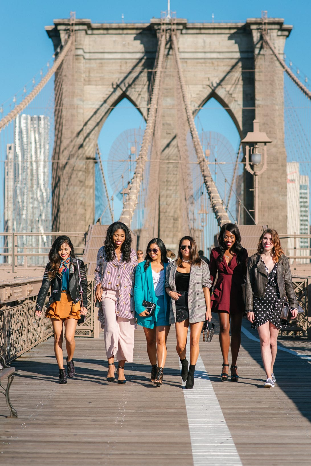NYFW, NYFW OUTFIT, NYFW STREETSTYLE, New York FASHION WEEK, NYFW 2017, BROOKLYN BRIDGE, BROOKLYN BRIDGE PHOTO SHOOT, AGACI, SATIN SKIRT, RUFFLE TOP, BLACK STUDDED BOOTIES. SCARF, TIE SCARF, CAMERA BAG, BOSS BABES, GIRL GANG, BLOGGER BABES