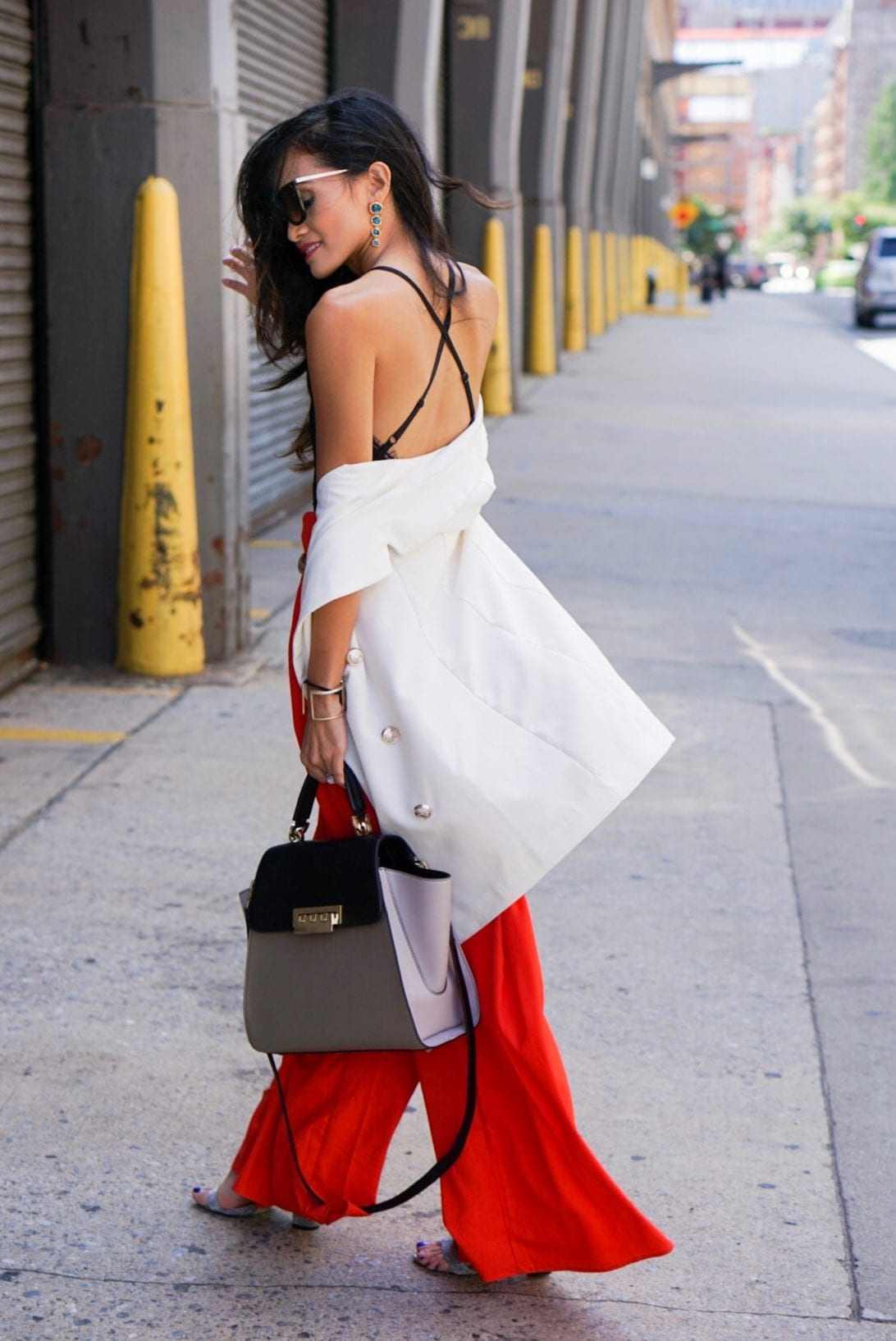 RED WIDE LEG PANTS, AGACI, NYFW SEPTEMBER 2017, NYFW STYLE, NYFW OUTFITS, New York FASHION WEEK, BLACK LACE BODYSUIT, PRADA SUNGLASSES, WHITE VEST, Zac Zac Posen bag