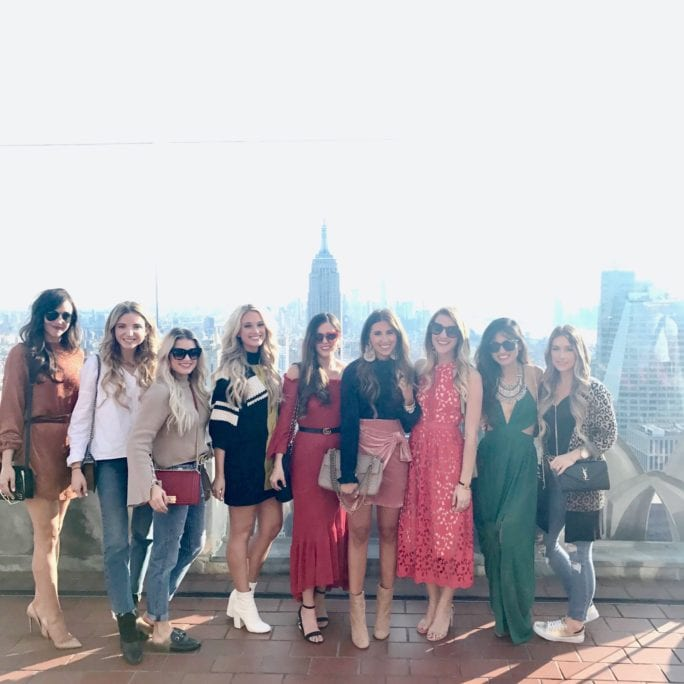 NYFW 2017, NYFW, New York FASHION WEEK, NYC travel guide, things to do in NYC, places to take pictures in NYC, top of the rock, Rockefeller center, pared sunglasses, green dress, FASHION BLOGGERS