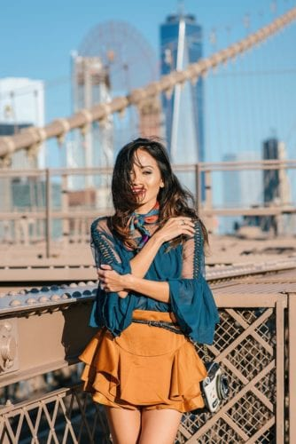 NYFW, NYFW OUTFIT, NYFW STREETSTYLE, New York FASHION WEEK, NYFW 2017, BROOKLYN BRIDGE, BROOKLYN BRIDGE PHOTO SHOOT, AGACI, SATIN SKIRT, RUFFLE TOP, BLACK STUDDED BOOTIES. SCARF, TIE SCARF, CAMERA BAG