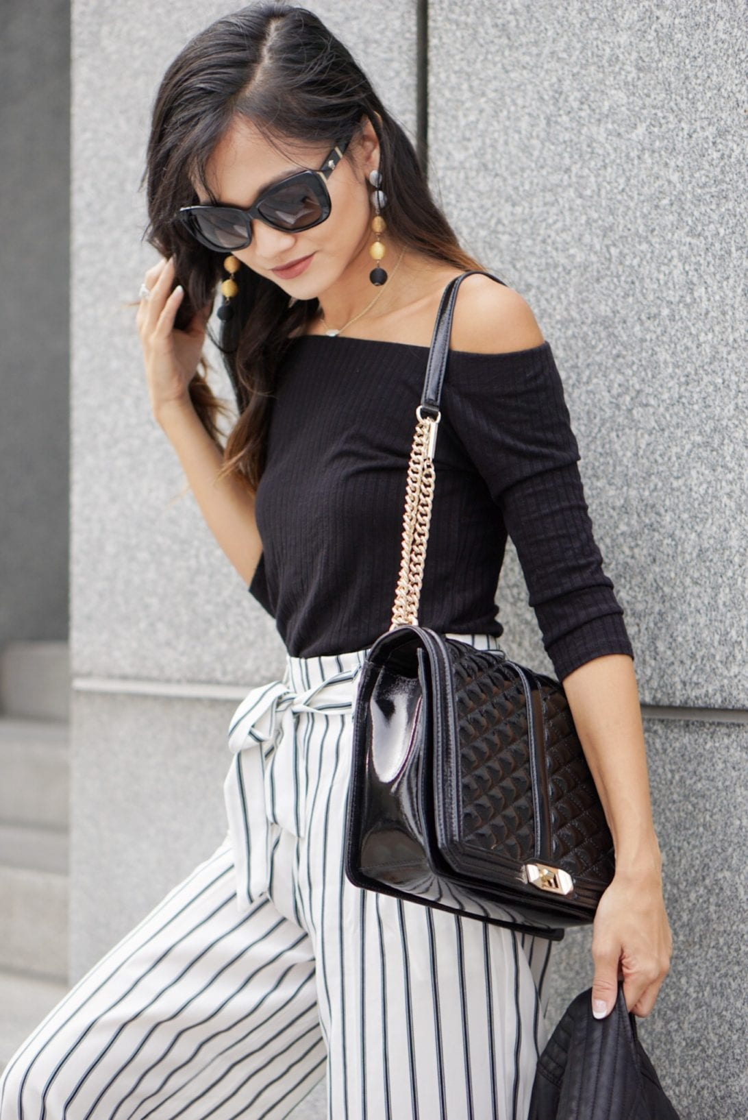 work wear outfit, business causal outfit, striped pants, culottes, wide leg pants, striped wide leg pants, Versace sunglasses, leather Moto jacket, love crossbody bag, Rebecca minkoff, black block heels, how to wear wide leg pants, outfit idea, outfit inspiration , bauble bar earrings