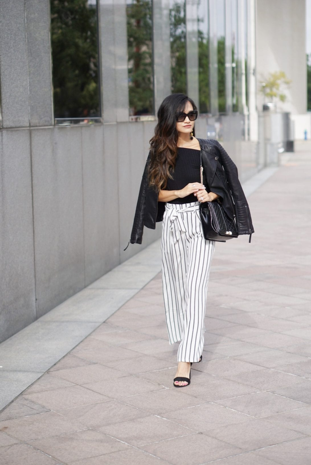 work wear outfit, business causal outfit, striped pants, culottes, wide leg pants, striped wide leg pants, Versace sunglasses, leather Moto jacket, love crossbody bag, Rebecca minkoff, black block heels, how to wear wide leg pants, outfit idea, outfit inspiration