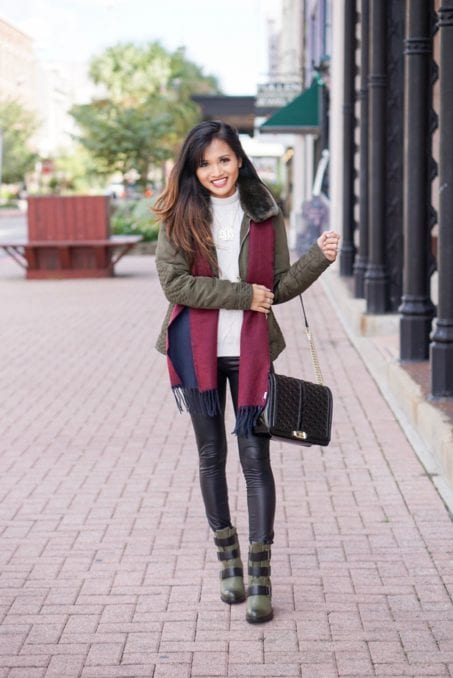 Sorel boots, holiday packing list, vacation packing list, winter packing list, faux leather pants, green puffer jacket