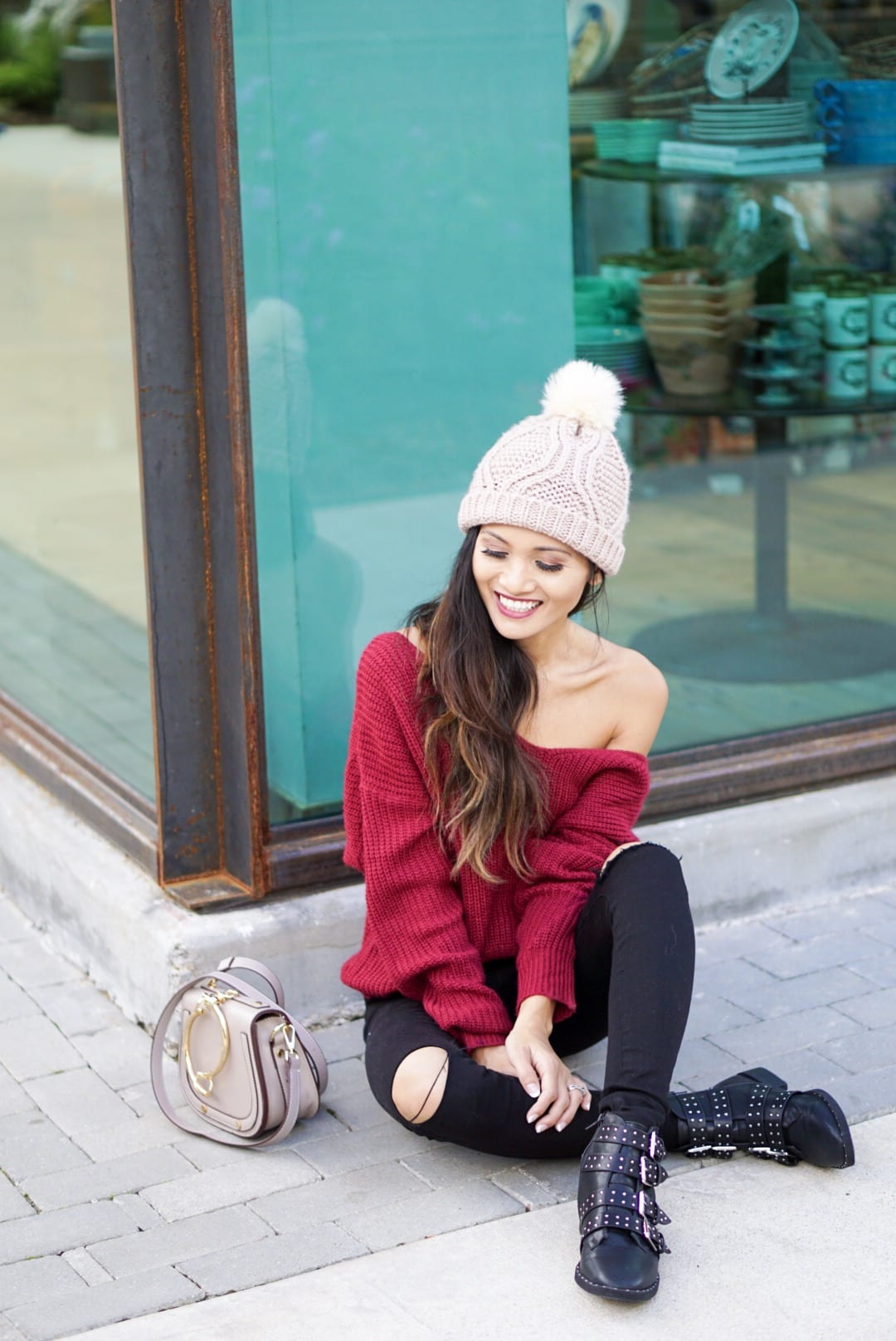 knot back sweater, pom pom beanie, studded boots, black ripped jeans, Chloe dupe bag, winter style, winter fashion. holiday outfit, winter outfit, christmas gift guide, gifts under $50