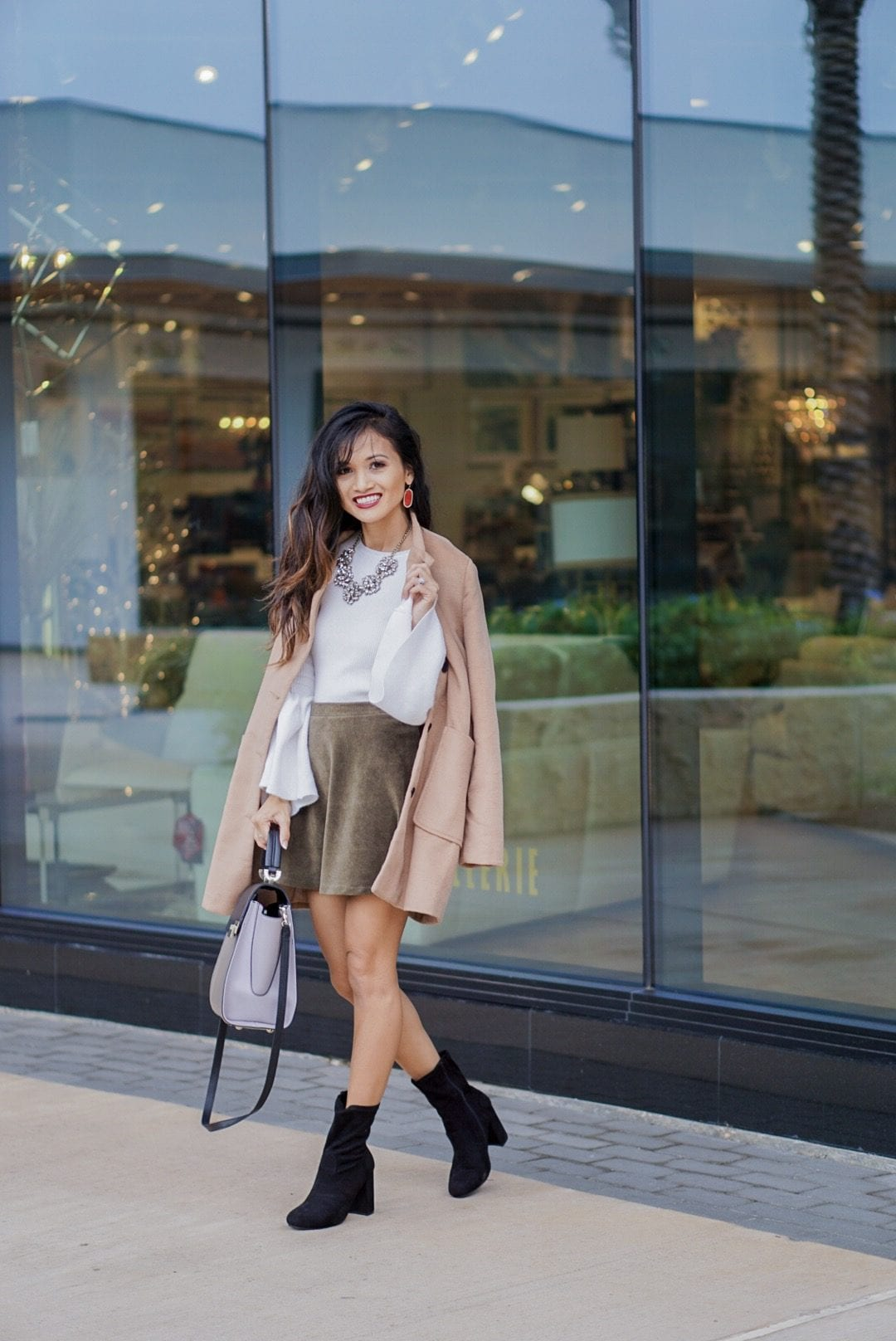 camel coat, corduroy skirt, black sock booties, winter outfit, white bell sleeve top