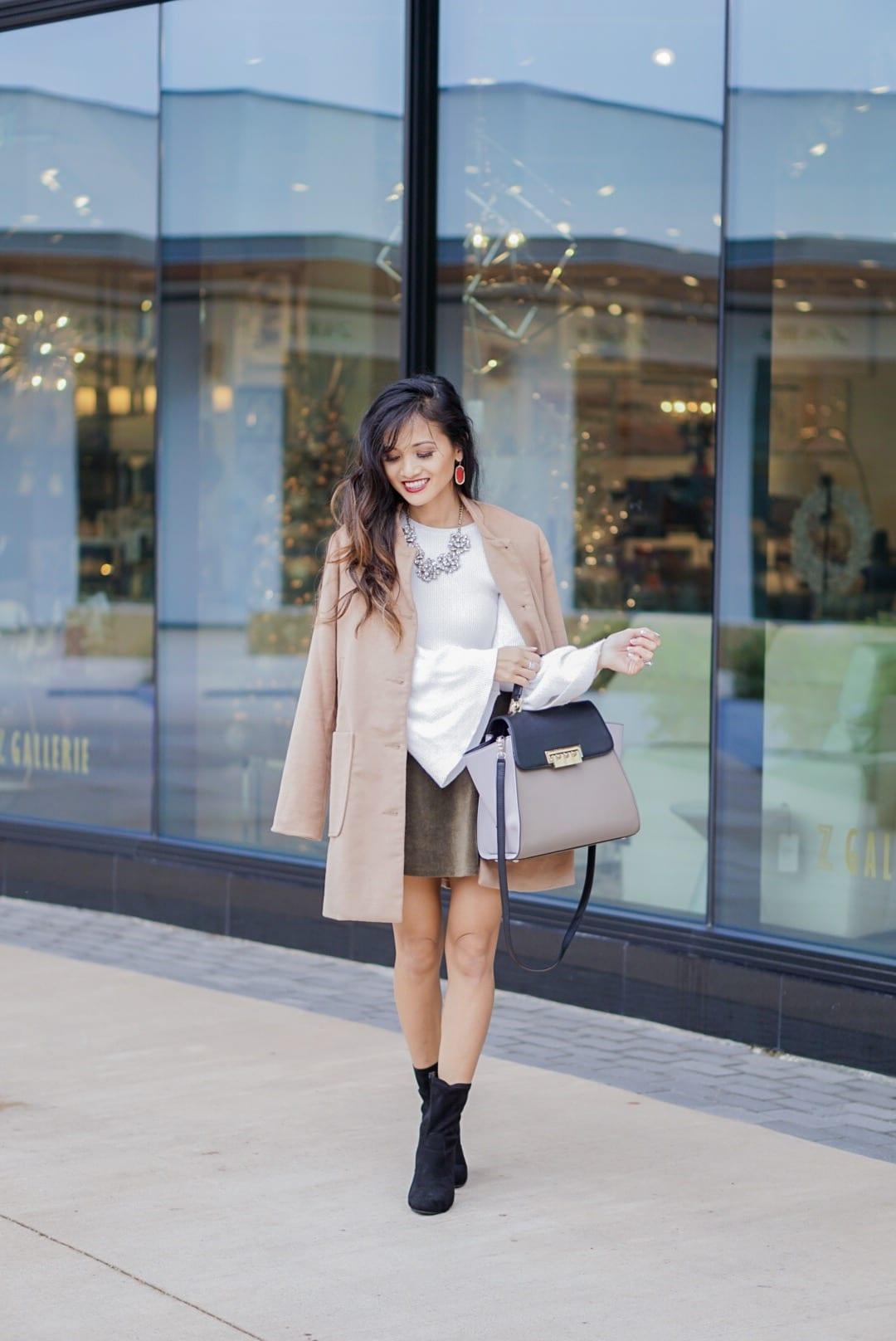 camel coat, corduroy skirt, black sock booties, winter outfit, white bell sleeve top, Zac Posen bag, red Kendra Scott earrings