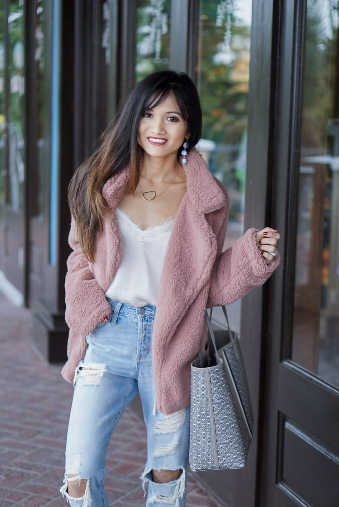 pink jacket, pink teddy bear coat, Tory Burch Gemini Link Tote, sherpa coat, ripped jeans, mom jeans, boyfriend jeans, dc canvas slip on shoes , initial necklace