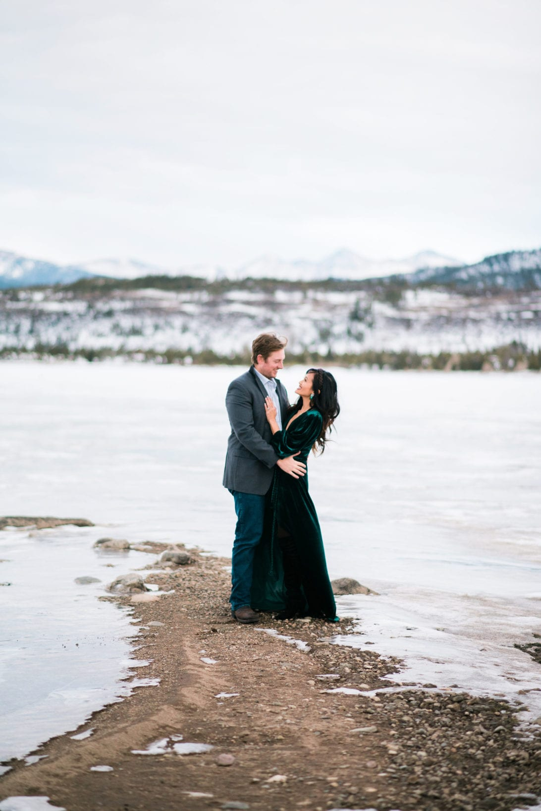 family pictures, snow family pictures, Colorado family pictures, frozen lake, christmas card family pictures, boy mom, green velvet dress, velvet dress, engagement pictures, couples pictures