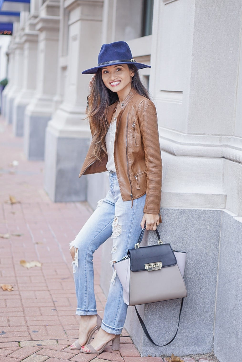 brown leather jacket, moto leather jacket, mom jeans, distressed jeans, navy felt hat, Steve Madden Carson sandal, white lace cami, Zac Zac Posen bag, spring outfit