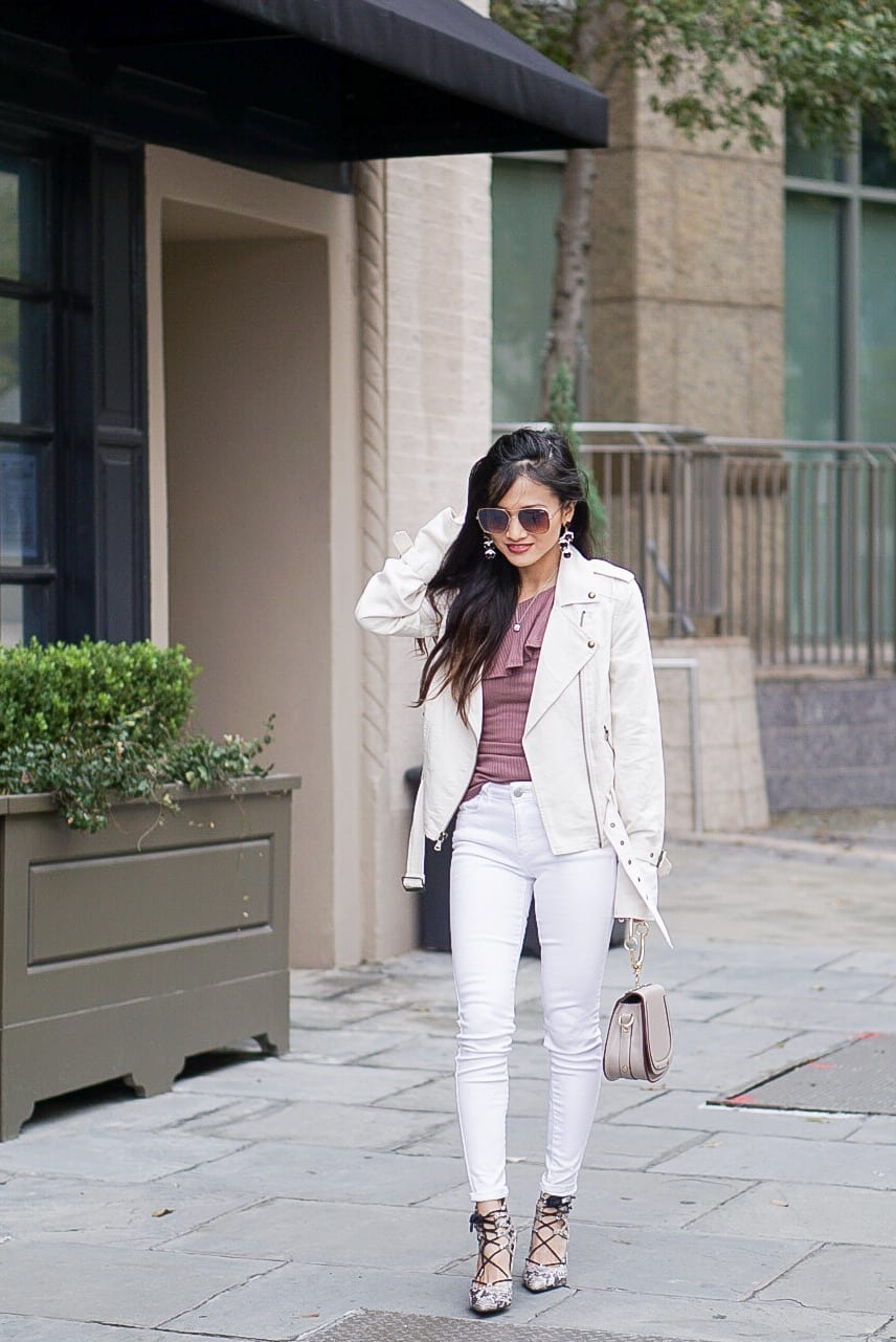 Paige papyrus moto jacket, white on white, white jacket, white moto jacket, one shoulder ruffle top, quay sunglasses, bauble bar earrings, white denim, white denim outfit, winter to spring outfit, small chested outfit, tips for styling with small breast, lace up heels