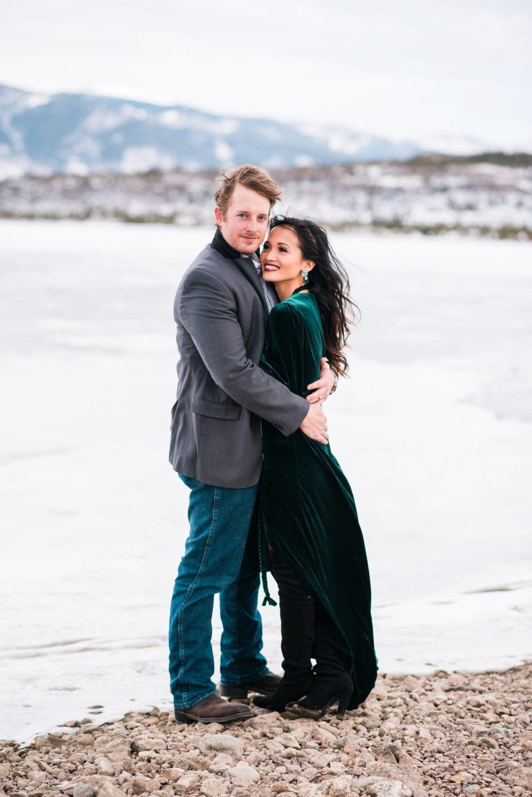 family pictures, snow family pictures, Colorado family pictures, frozen lake, christmas card family pictures, boy mom, green velvet dress, velvet dress, engagement pictures
