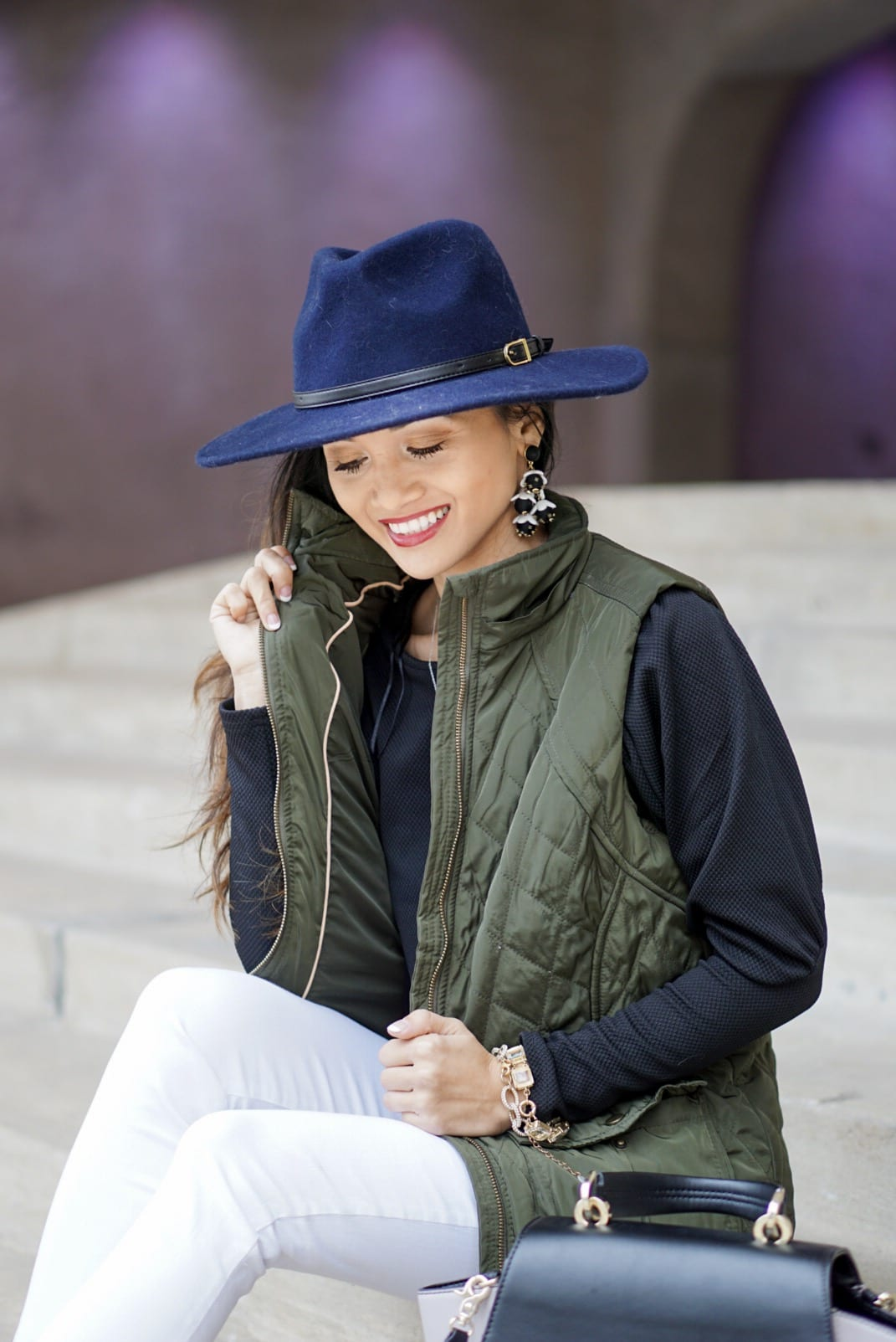 utility vest, green vest, Zac Posen bag, white jeans, white denim outfit, lace up heels, navy felt brim hat, red dress boutique, puff sleeves, bauble bar earrings, statement earrings, how to wear a vest, winter outfit, how to style a hat