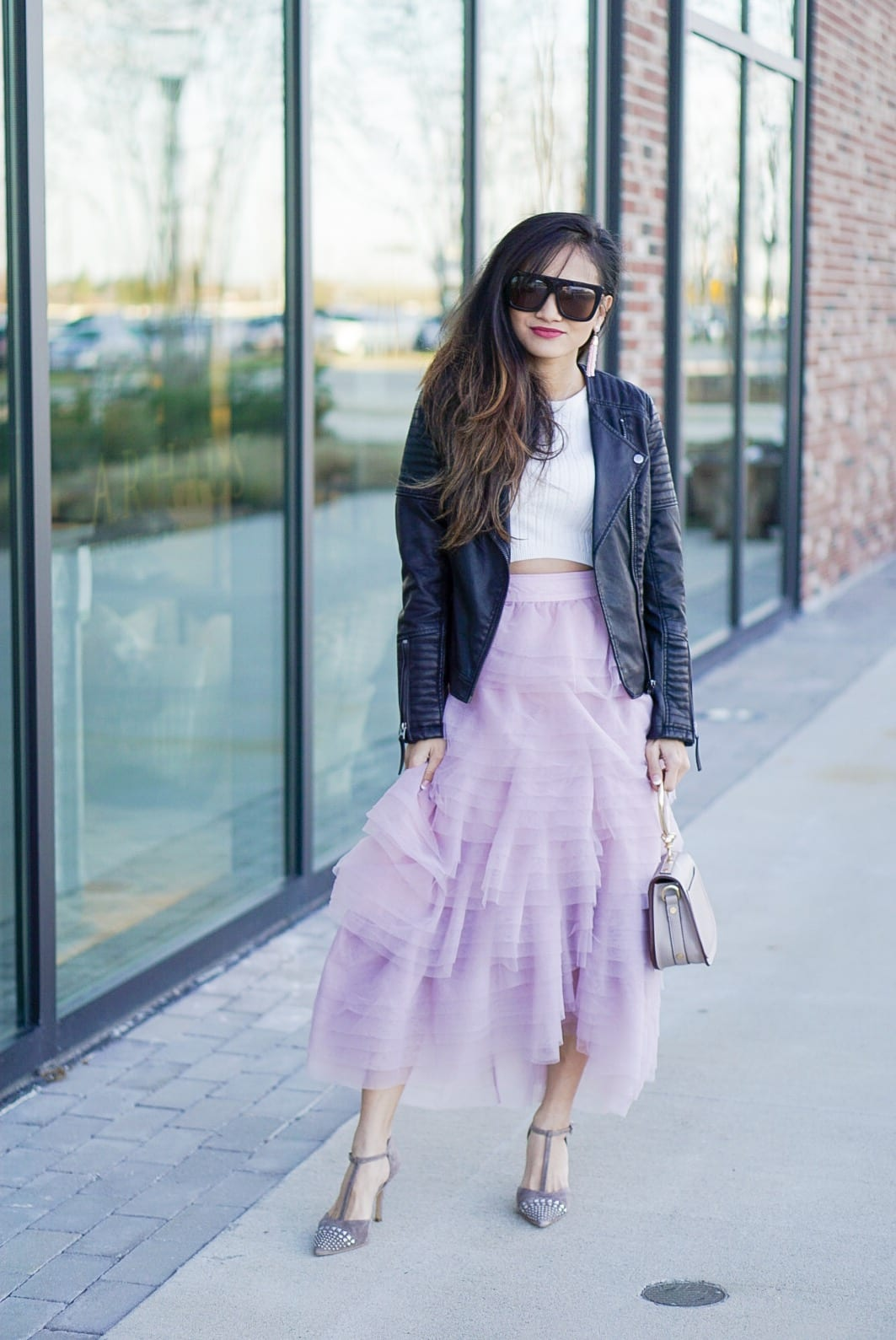 pink tulle skirt, toyshop moto jacket, black leather jacket, date night look, valentine's outfit, sex and the city style, Chloe bag, pink skirt, how to wear a tulle skirt, quay sunglasses, cafe racer