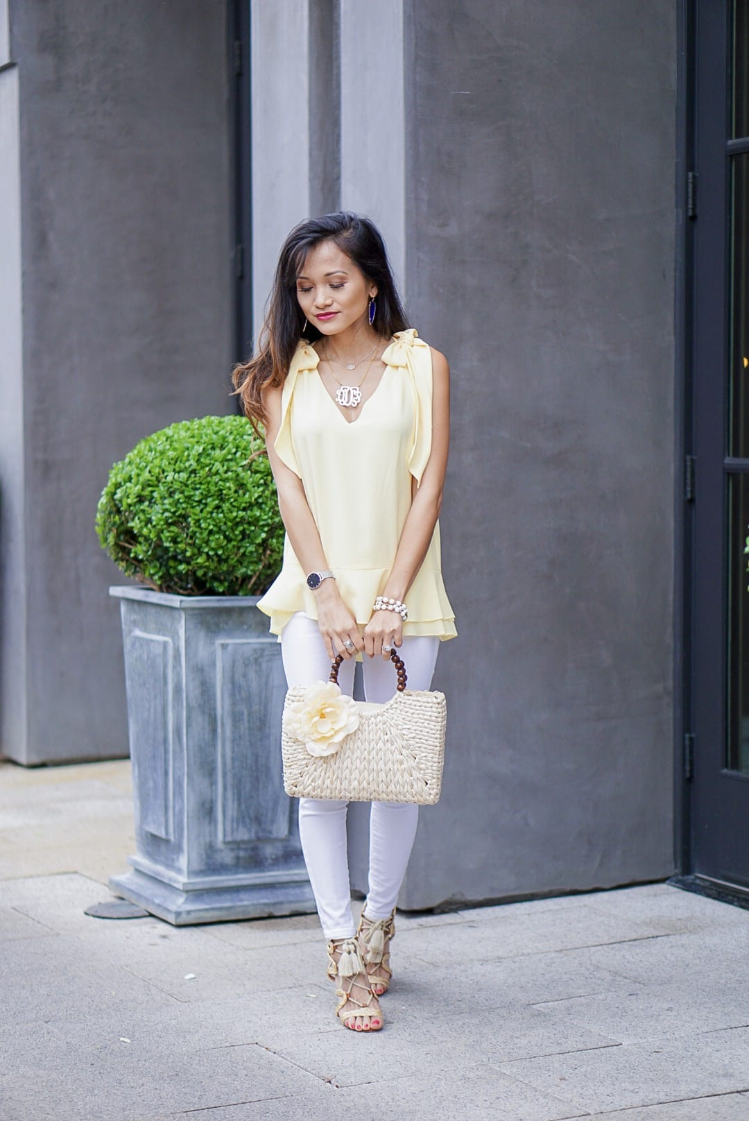 yellow tie shoulder blouse, yellow tie sleeve top, peplum top, easter, easter outfit, spring style, spring fashion, straw bag, woven heels, wrap heels, pastel yellow, white jeans