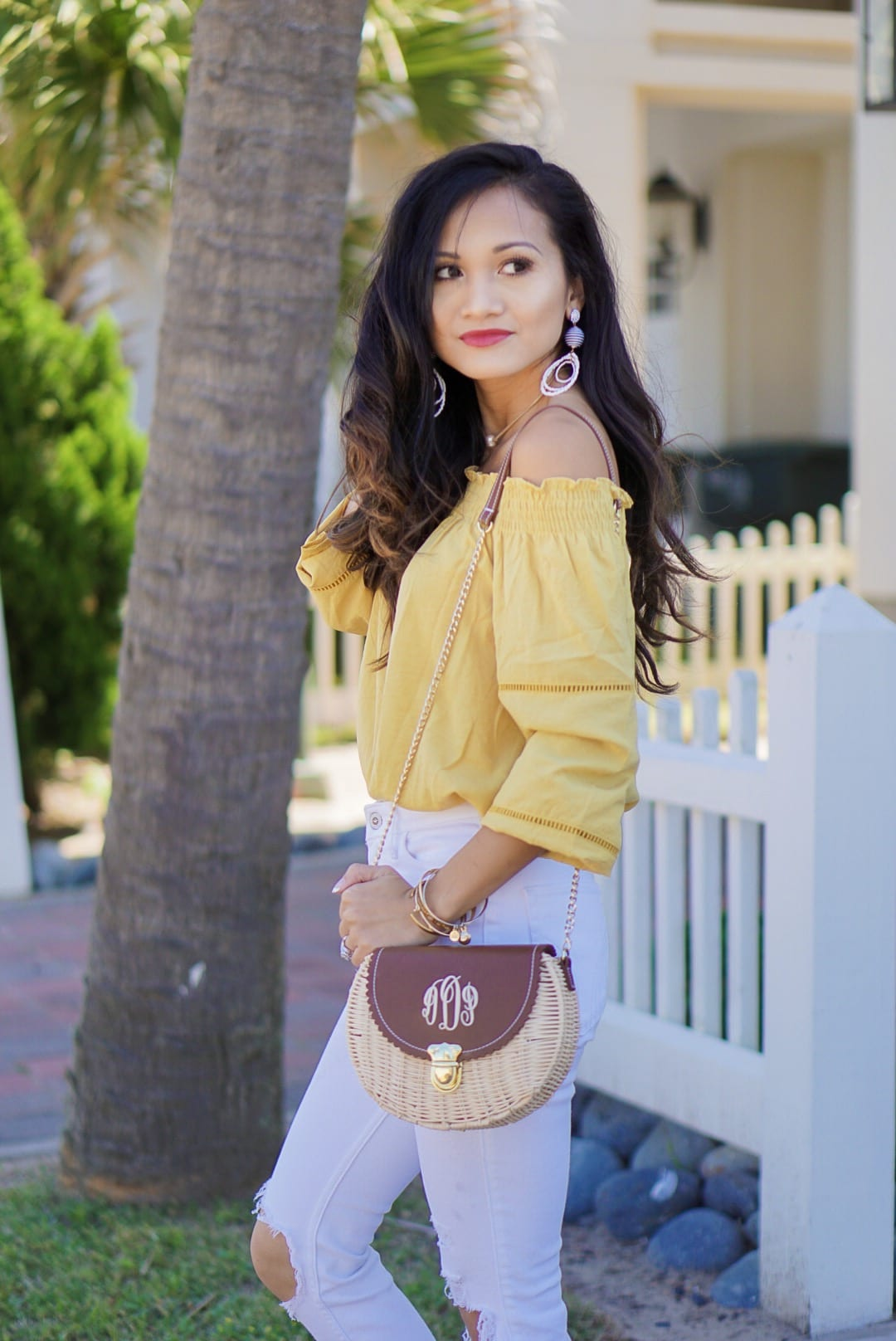 off the shoulder, cinco de Mayo, red embroidered dress, yellow statement earrings, bamboo bag, straw bag, yellow off the shoulder top, Betsy Boo's Boutique, red gingham top, Soludos platform sandals