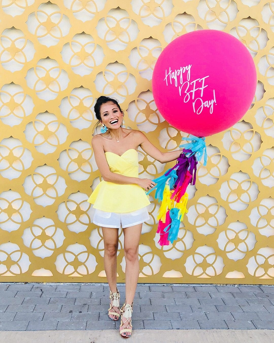 KENDRA SCOTT, FUNDRAISER, #NATIONALBFFDAY, BIG ASS BALLOONS, LAUREN JAMES #SUMMERSTYLE, #SUMMERFASHION, YELLOW PEPLUM TOP, WHITE TIE FRONT SHORTS, LACE UP SANDALS