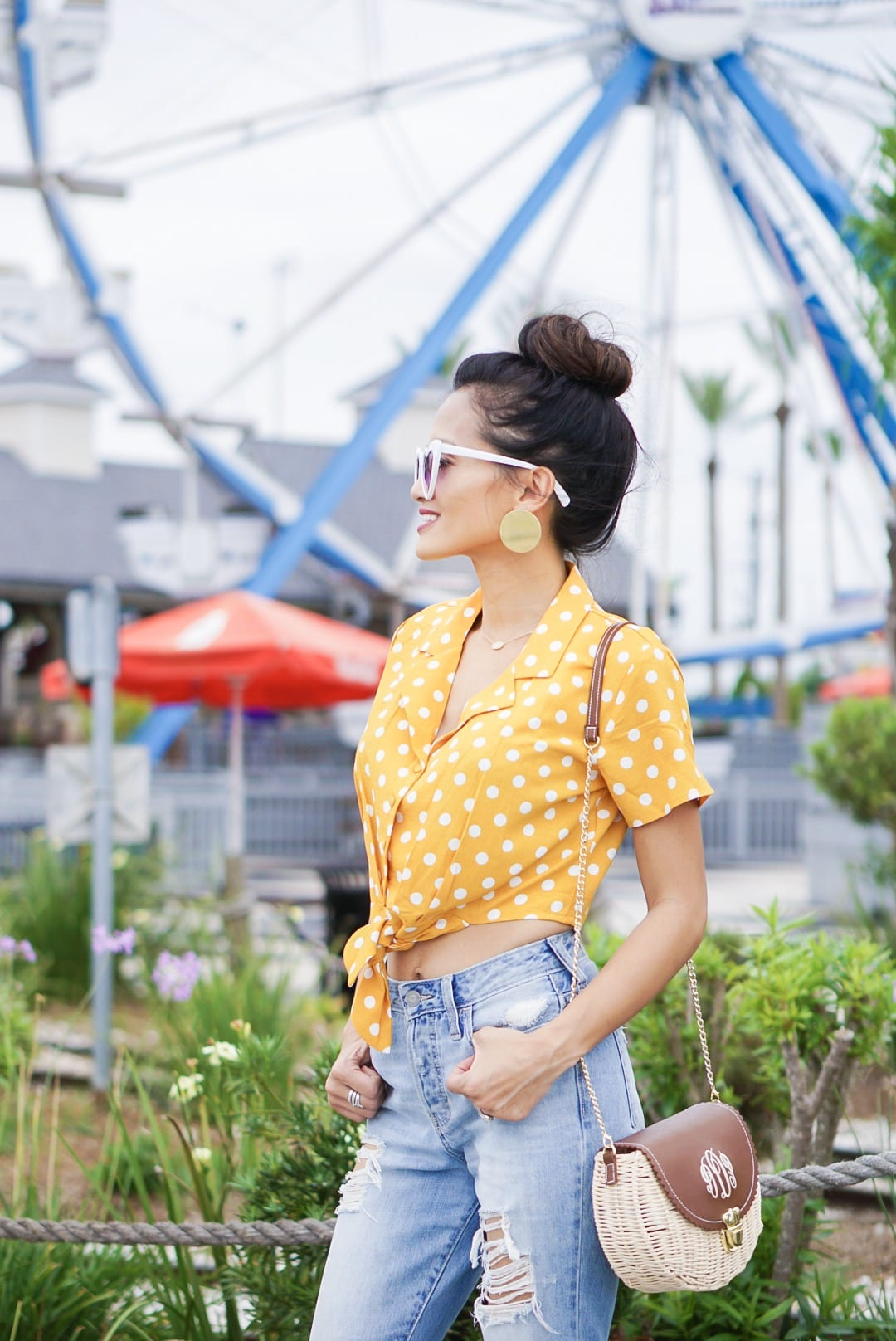 , polka dot, polka dot blouse, polka dot top, yellow polka dot, summer style #summerfashion, heart shaped glasses, monogrammed bag, straw bag, woven sandals, 60's inspired fashion, affordable fashion, mom jeans