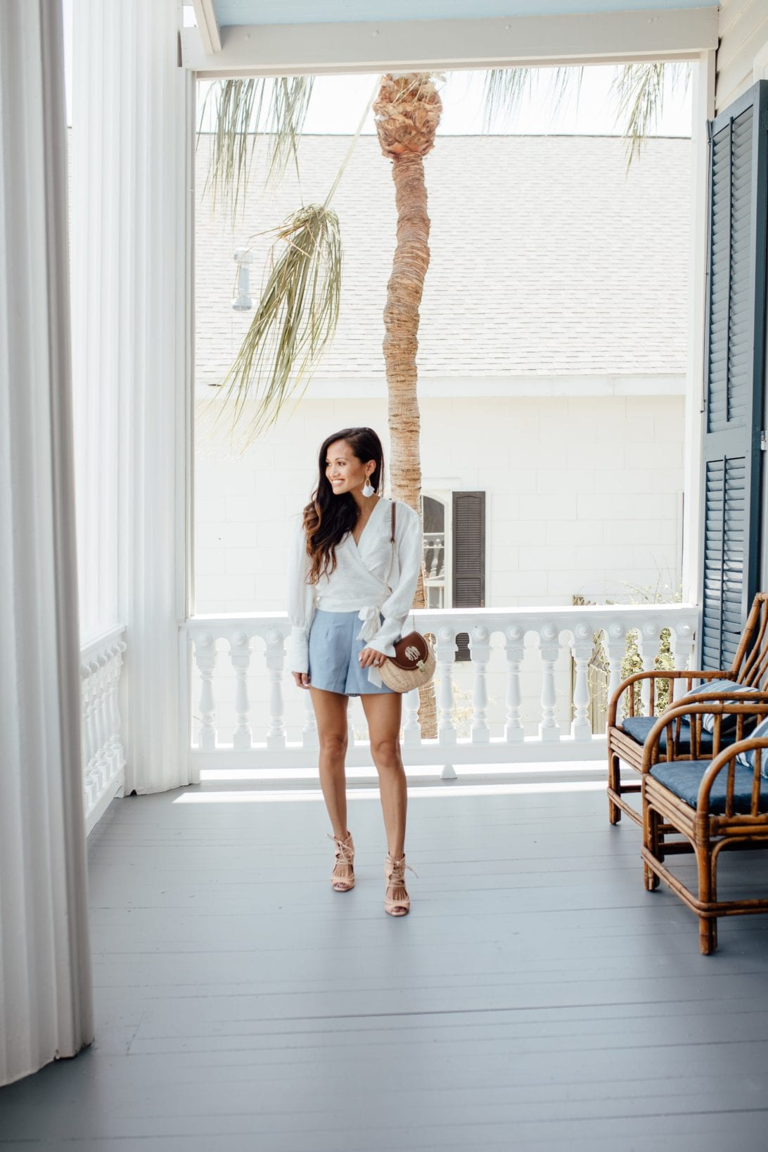 wrap blouse, GRLFRND denim,  REVOLVE, SUMMER STYLE, CROPPED JEANS, CARR MANSION, GALVESTON, SUMMER STYLE, SUMMER OUTFIT, MONOGRAMMED BAG, WICKER BAG, LISI LERCH EARRINGS, CHICWISH