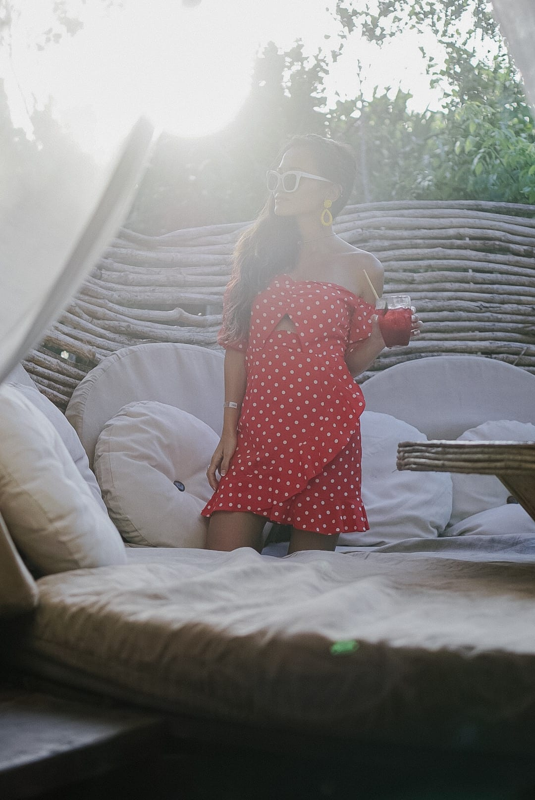 Kin Toh, Azulik, Tulum, Mexico, #travelstyle, #travelblogger, #vacationstyle, #dawnpdarnell, #houstonblogger, red polka dot dress, white cat eye sunglasses, Lisi Lerch earrings
