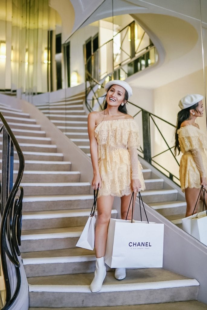 white Chanel shopping bag, Chanel grand staircase, Paris, Parisian style, Parisian outfit