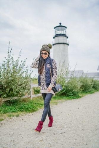 Chanel bag, pom pom beanie, quilted vest, monogrammed vest