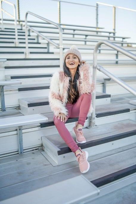 pink fur coat, pink sneakers, pink leggings, pink sports bra