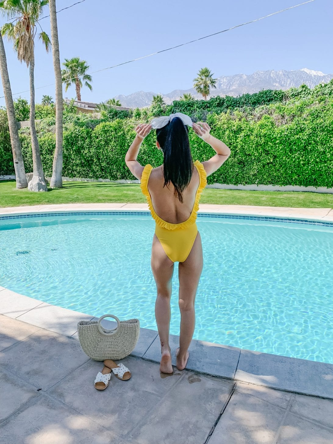 yellow swimsuit, Palm Springs, straw bag