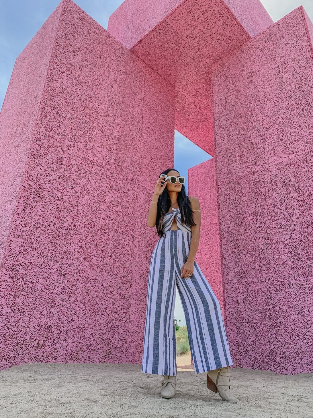 PINK WALL, JUMPSUIT, WHITE SUNGLASSES