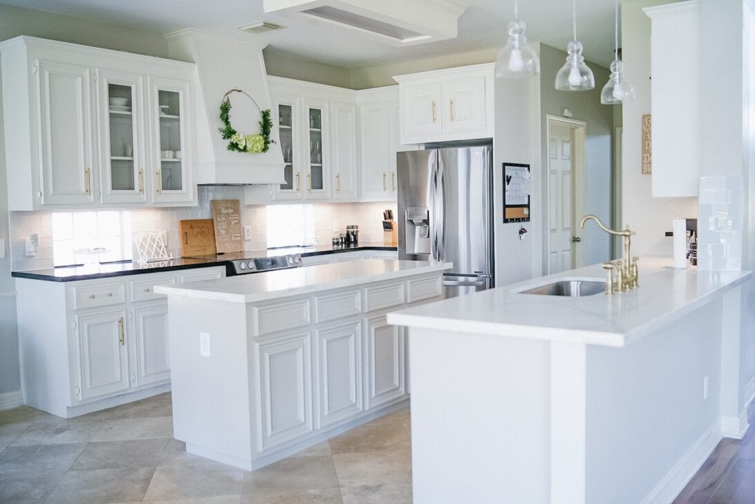 quartz countertops, white kitchen, grey cabinets, black countertops