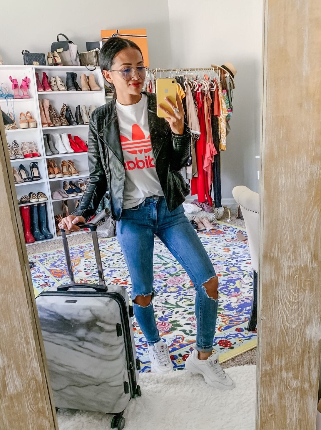 ADIDAS SHIRT, CASUAL STYLE, BKIER JACKET, TOPSHOP FAUX LEATHER JACKET, BLUE LIGHT GLASSES, FREE PEOPLE JEANS, ADIDAS SHOES, CALPAK LUGGAGE