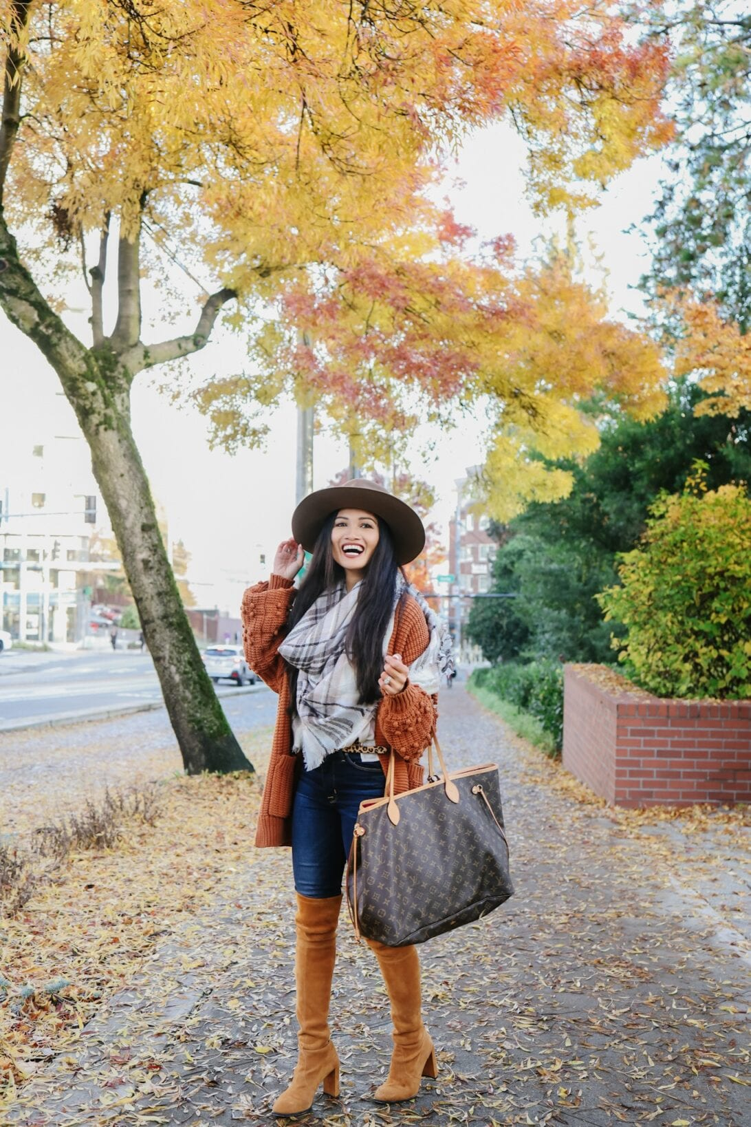 Louis Vuitton Neverfull, brown fedora, orange cardigan, Stuart Weitzman Hiline boots, over the knee boots, scarf , Seattle fall trees